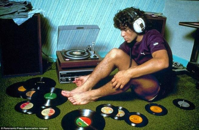 Diego-Maradona-listening-to-records-1980